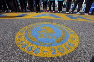 An seal honoring 50 years of women running in the Boston Marathon covers the street in front of the start line of the 120th Boston Marathon on Monday, April 18, 2016, in Hopkinton, Mass. (AP Photo/Michael Dwyer)