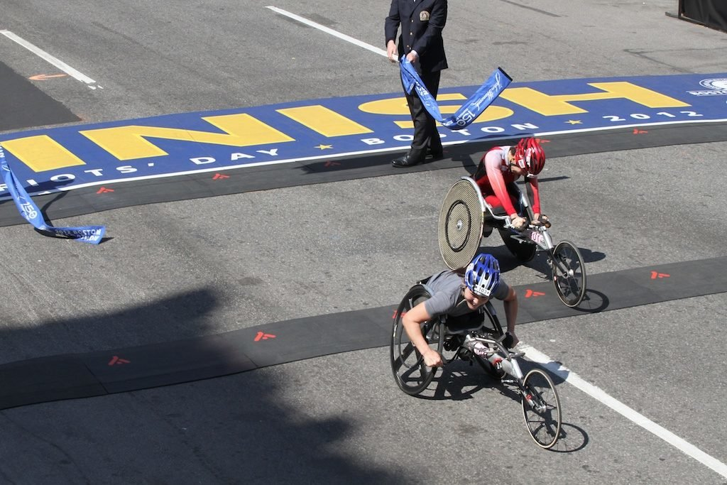 Apr.16, 2012-The first wheerchair winner Shirley Reilly from USA crosses the finish line one second before the second winner Wakako Tsuchida from Japan at 116th Boston Marathon. First winner: 1:37:36/ Second winner: 1:37:37 (Hyunah Jang / Boston University News Service)