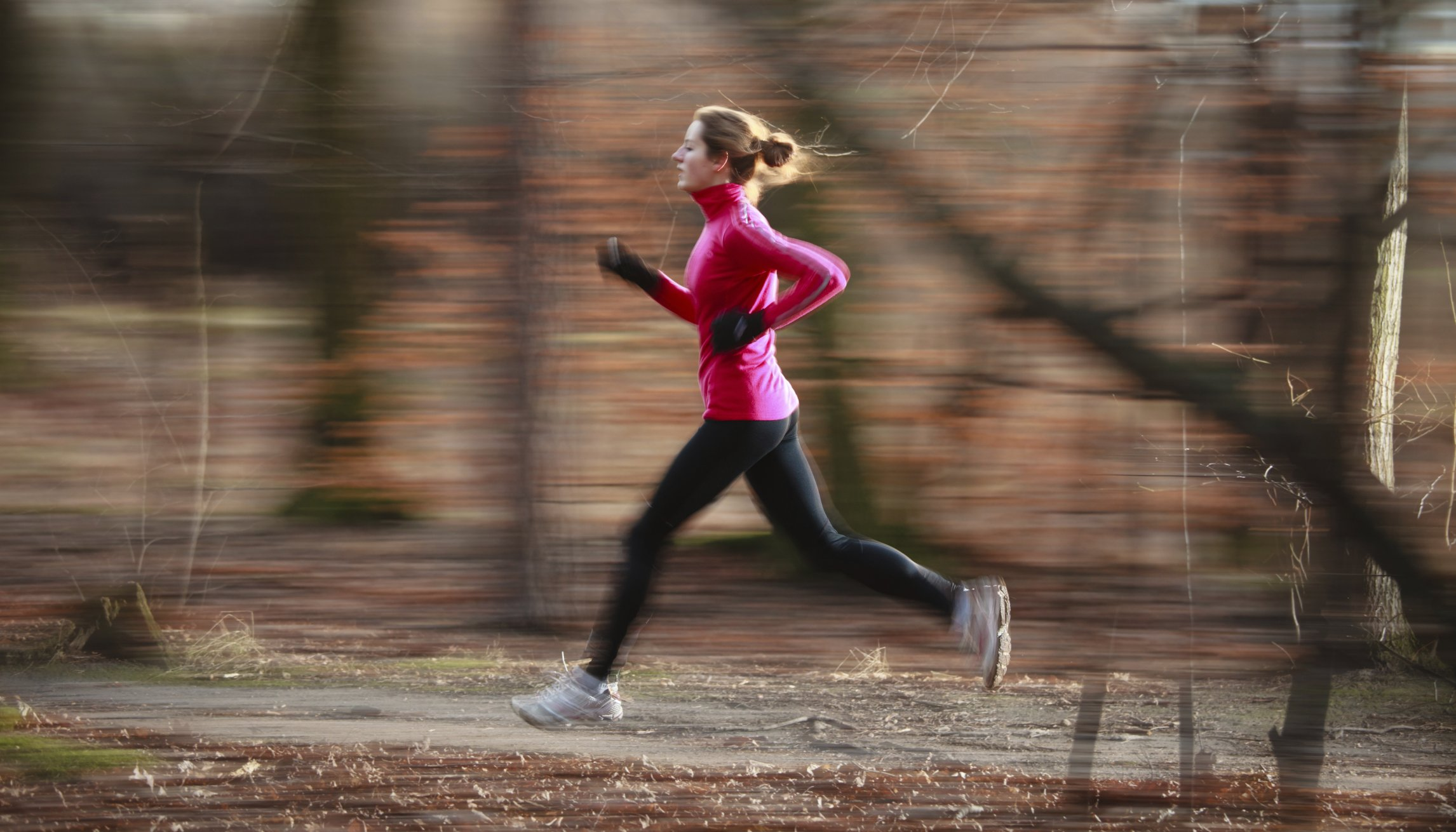 Young woman running outdoors in a city park